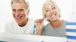 Elderly couple brushing teeth